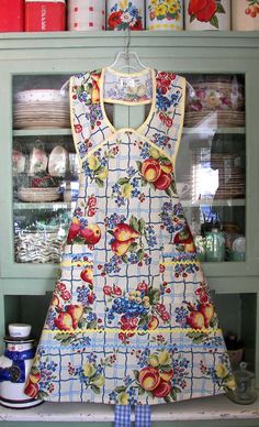 1940 Old Home Fruit  Woman Apron#2062 $49.95 ex large add $5.00  Child apron#317 $45.95  Nostalgic pretty 1940 apron in Old Home Fruit with apples, pears and flowers. A soft cream background, a pretty apron for you to enjoy in the kitchen.   Beautiful fruit with retro background. Yellow and blue rick rack with soft yellow trim top off this old fashioned apron.
