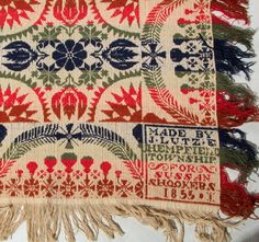 """Sold $450  PENNSYLVANIA SIGNED JACOB LUTZ JACQUARD COVERLET, two joined panels, blue, green, red and white, alternating bands of sunburst, stylized tulips with rosettes and snowflakes, three sides with scalloped feather bands, crosses, stars and fringed edge, top with a later 19th century red and white print fabric binding. Two corner blocks with """"MADE BY / J. LUTZ E. / HEMPFIELD / TOWNSHIP / FOR / SUSAN / SHOOKERS / 1855.*"""". 1855. 88"""" x 97"""". From a Loudoun County, Virginia estate…"""