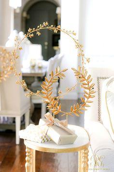 gold laurel wreath stands  #christmasdecorideas #christmasdecorations #christmasdecorationideas #beautifulchristmasdecorations #holidaydecorideas #holidaydecoratingideas #holidaydecorations #holidaydecor  #elegantchristmas #glamchristmasdecor #whitechristmasdecor