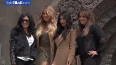 Kim Kardashian and sister Khloe were swarmed with fans as they headed out in the Armenian capital Yerevan to visit the city's tourist spots.