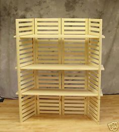Collapsible shelving, could easily make this with wood shutters, remove a few lats to make room for the shelf to slide in, maybe add some footing pieces for added stability and tada! Cute collapsible shelf! :)