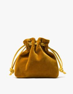 From Clare V., a minimalist shoulder bag in Gold. Featuring a velvet…
