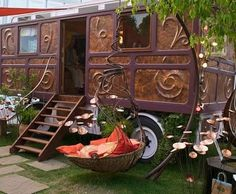 I don't know what's cooler, the caravan or the hanging chair