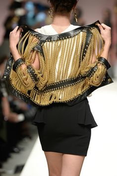 Moschino s/s 2014. this is soooo happening. i have so much chain lying around that i'm going to use!! need a thrift jacket.