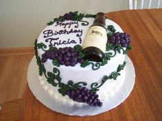 Wine bottle - This cake was for a friend of my Mom's.  This idea was taken from a picture the bday girl liked that my Mom found.  Gumpaste bottle, buttercream grapes & leaves.