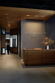 Goodwater Capital Office & Identity by Atelier Cho Thompson Goodwater Capital came to us with the mission to empower entrepreneurs who would change the world. We conceived of a brand and visual identi Office Reception Design, Small Office Design, Industrial Office Design, Corporate Office Design, Dental Office Design, Corporate Offices, Office Designs, Office Signage, Modern Offices