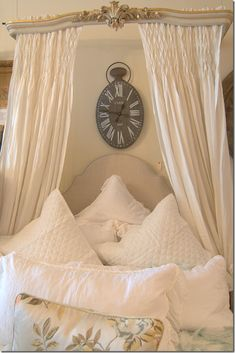 Beautiful headboard and cornice displayed at Olivine, and featured on Cote De Texas blog.