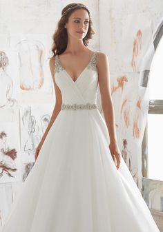 Designer Wedding Dresses and Bridal Gowns by Morilee. This Organza Wedding Ballgown Combines a Traditional A- Line Silhouette with Modern Details.