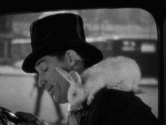 Having accidentally inhaled some ether and fallen asleep at the wheel of the taxi he hijacked, Cary Grant is alarmed to find that one of a crate of bunnies has escaped and decided to keep him company in Kiss and Make-Up (1934).