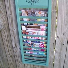 Easy repurposed shutter project uses part of a bi-fold door with ever other slat removed to make a great magazine rack.