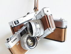 "In the documentary Objectified, one of the designers asks ""Why do we still make cameras the same shape they've been for decades?"" Seems obvious to me. It's because they're beautiful (and nostalgic) that way."