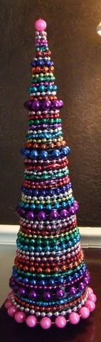 Mardi Gras Bead Christmas topiary--Kate Hoefer, this one is for you! (Via my dear friend, Jen, who knows how I love making Mardi Gras bead stuff.) This ROCKS.