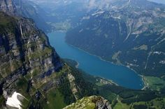 Klöntalersee is a natural lake in the Canton of Glarus, Switzerland. Since 1908, it has been used as a reservoir for electricity production. The dam's construction substantially increased the lake's volume.  Klöntalersee is drained by the Löntsch, a left tributary of the Linth.