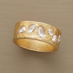 "Romantic treasures awaiting discovery, gleaming diamonds are preserved forever on a chiseled band of 18kt gold. Handcrafted in USA by Annie Fensterstock. .90 approximate total carat weight. Whole sizes 5 to 9. 5/16""W."
