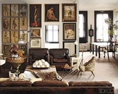 Great art especially grouping on the left.  Love old, worn, brown leather chairs and couch.