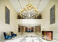 The past dark lobby of the former Observatory Hotel has transformed into a bright entrance to the Langham Sydney.