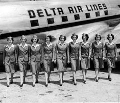 Delta's flying beauties 1945 – Nine of Delta's flying beauties shown beside a big transport on the apron of the Atlanta Airport. From left to right: Isabel Sanders, Martha Watkins, Josephine Pate,. Delta Flight, Atlanta Airport, Airline Flights, Civil Aviation, Cabin Crew, Yesterday And Today, Flight Attendant, Vintage Travel, Air Lines