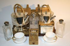 """Edwardian Picnic Set supplied by The Sheffield Plate Co, 14 Rue de la Pepiniere, Paris, with silver plated fittings including spirit kettle and stand, teapot, sugar basin, tea caddy, milk jug, biscuit box, vesta box, set 6 teaspoons, 3 glass bottles with plated tops, 6 Royal Worcester teacups and saucers (date marks for 1907), all contained in suede covered frames on leather covered tray base and leather covered box top"""