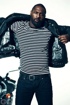 Idris Elba wearing Black Leather Biker Jacket, White and Black Horizontal Striped Long Sleeve T-Shirt, Navy Jeans, Black Leather Belt Idris Elba, Men In Black, Black White, Norman Jean Roy, Jeans Bleu, Navy Jeans, Men's Jeans, Looks Black, Black Leather Belt