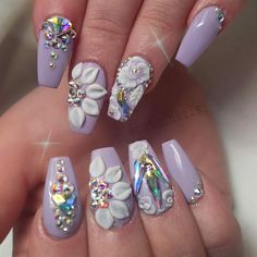 Sorry for the quality of the picture. My phone died right as I was about to take a picture and I had to borrow a camera  the stones were so pretty though.  #3dflowers #acrylicdesign #swarovskicrystals #hahanails #lavendernails #prettynails #hairandnailfashion #naildesigns #swannails #chinaglaze #youngnails #nailswag #nailporn #nails #coffinnails #forms #nailsoftheday #nailstyle #coffinnails #glam #hudabeauty #nailpro #nailstyle #nailprodigy