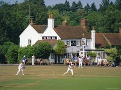 Village Green Cricket, Tilford, Surrey. The dull thud of willow against leather can often be heard in an English village of a summer Sunday afternoon....