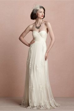Luella Gown  25069386  Finely ruched tulle flows up and around a fitted bodice before softly floating into a lacy skirt. Catherine Deane's airy and romantic dress is both subtle and breathtaking, and pairs well with a sash or statement necklace. Back zip. Professionally clean. Imported.
