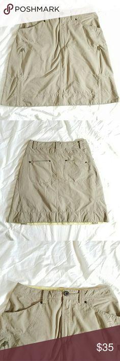 Mountain Hardwear Skirt Amazing Mountain Hard Wear skirt, lots of pockets, great style, goes with everything. Great condition.   SIZE 4 Mountain Hard Wear Skirts Midi