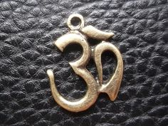 A personal favorite from my Etsy shop https://www.etsy.com/listing/166919685/3-pcs-vintage-om-brass-pendant-on-hindu