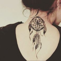 small dreamcatcher tattoo on back of neck