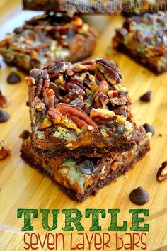 Chewy, gooey Turtle Seven Layer Bars packed with buttery caramel, rich milk chocolate and salty roasted pecans. You won't be able to stop at one!