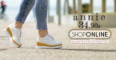 Δίπατα γυναικεία διάτρητα παπούτσια τύπου oxford σε μαύρο & λευκό.