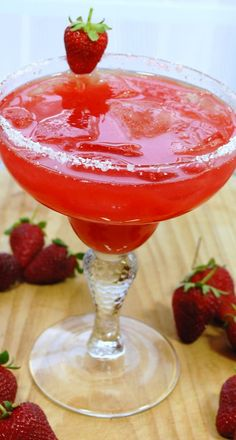 STRAWBERRY MARGARITA  (makes 4 margaritas)  - salt  - lime wedges  - 1 cup tequila  - 1 cup fresh strawberry juice, strained  - 1/3 cup fresh lime juice  - 1/2 cup Cointreau  - ice cubes