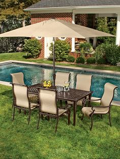 Exquisite details mark this 7-piece outdoor dining set from the Brigantine Collection---from the ornate scrollwork of the aluminum-cast tabletop to the wavy backs and curved armrests of the sling-fabric chairs (6). Umbrella sold separately. Online only. #shopko