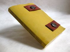 Yellow leather sketchbook with brown leather closures $60