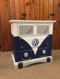 Small dresser painted to look like a blue Volkswagen bus. Annie Sloan Napoleonic Blue and Pure White. Working headlights!