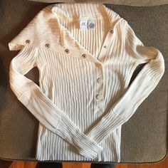 Armani exchange white button neck sweater Armani exchange white colored button neck sweater. Size small true to size. 90% Cotton 10% cashmere material. Armani Exchange Tops Sweatshirts & Hoodies