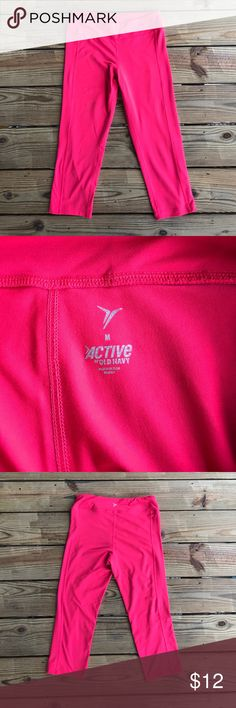 Bright Pink Capri-Length Leggings These are bright pink leggings from Old Navy size medium. There is a built-in small pocket on the waistband. They are 85% polyester and 15% spandex. No rips, tears, or pulls. Very very minimal pilling, not noticeable at all when wearing, just wanted to include that for full disclosure. I am selling because they are too small. I loved wearing these and always received so many compliments on the awesome color! Super fun for working out or everyday wear. Old…