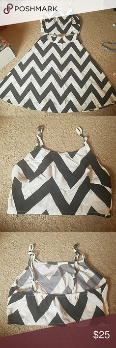 """2 piece chevron outfit - Crop Top & A Line Skirt 2 piece outfit! Chevron print Size Small Crop top has a side zipper, adjustable straps, and elastic back that allows for stretch. Top measures 14"""" across bust. A Line skirt has a zipper in the back and measures 13.25"""" across top and 24"""" in length. Made of 65% cotton and 35% polyester. Very lightweight material. Needs a good home! Other"""