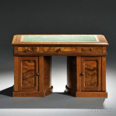 Sold for $7995 July 2014. Wooton Walnut and Burl Walnut Standard Grade Rotary Desk. Sales Model, Indianapolis, Indiana, last quarter 19th century, with a cloth-lined writing surface and two rotating pedestals: one side with various drawers and pigeonholes each with a green cardboard liner and the other side with various document slots and compartments, with a label from the Smithsonian Traveling Exhibition Service