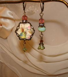Victorian crowned bird asymmetrical earrings by pameliadesigns, $27.00