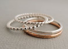 1 Rose Gold Ring and 3 Sterling Silver Rings 4 thin mixed stacking rings
