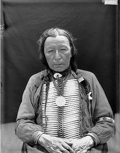 Portrait (Front) of Oglala He-Wanbli (Eagle Horn) in Partial Native Dress with Peace Medal and Breastplate AUG 1907