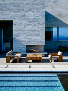 Brilliant Modern Stone Wall Home Design: Complete Outdoor Spot For Sitting With Modern Armchair And Sofa With Wooden Coffee Table Featured W...