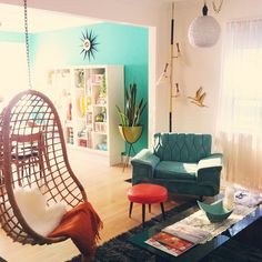 Hanging chair, bullet planter, teal lounge chair, lots of colour. Nice.
