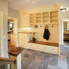 mudroom like the self with lighting and the little drawers for keys and a purse and wallets maybe. For umbrellas