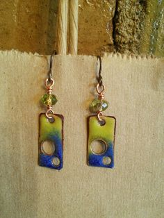 Check out this item in my Etsy shop https://www.etsy.com/listing/252518572/hand-crafted-fire-torch-enamel-earrings