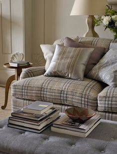 Colefax And Fowler's Kelburn Check (couch), Layton (ottoman), pillows from L-R: Suffolk, Juliana, Suffolk, Heywood #colefaxandfowler #textiles #fabrics