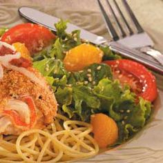 Sweet Sesame Salad Recipe -I jazz up salad greens with tomatoes, mandarin oranges and sesame seeds, then top it off with honey vinaigrette for a sweet and fruity sensation the whole family loves.—Kristine Marra, Clifton Park, New York