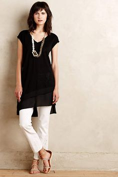Love the long tunic top, the white skinny jeans, and the sandals! Plus the necklace makes it all come together. Just my style!!
