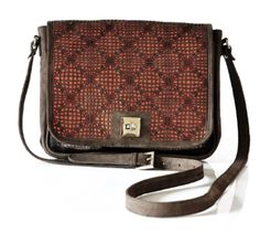 ZORA the ultimate Sling bag with intricate laser cut details and a twist lock. It has an adjustable shoulder strap. It is crafted in genuine leather and nylon net fabric. A casual day carry sling. Size : 28x5x24 cms.